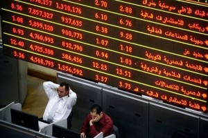 The EGX's weekly stock market summary showed that the total value of shares for companies listed dropped EGP 5.491bn last week, from EGP 380.950bn to EGP 386.441bn.(File Photo) (AFP Photo / Mahmoud Khaled)